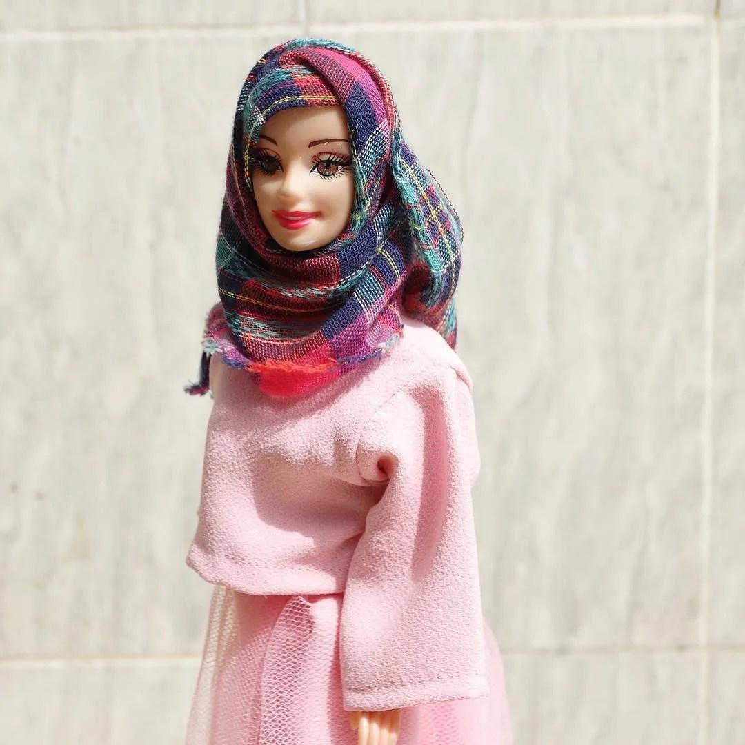Wearing modest outfits along with a hijab. Muslim Barbie Hijarbie Wears A Headscarf And Modest Dress Teen Vogue