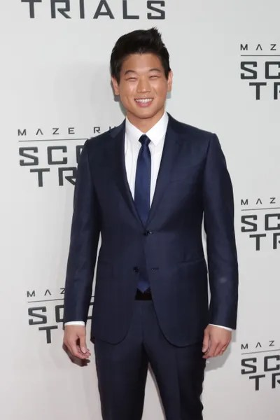 Image may contain Ki Hong Lee Clothing Apparel Coat Suit Overcoat Tie Accessories Accessory Human Person and Man