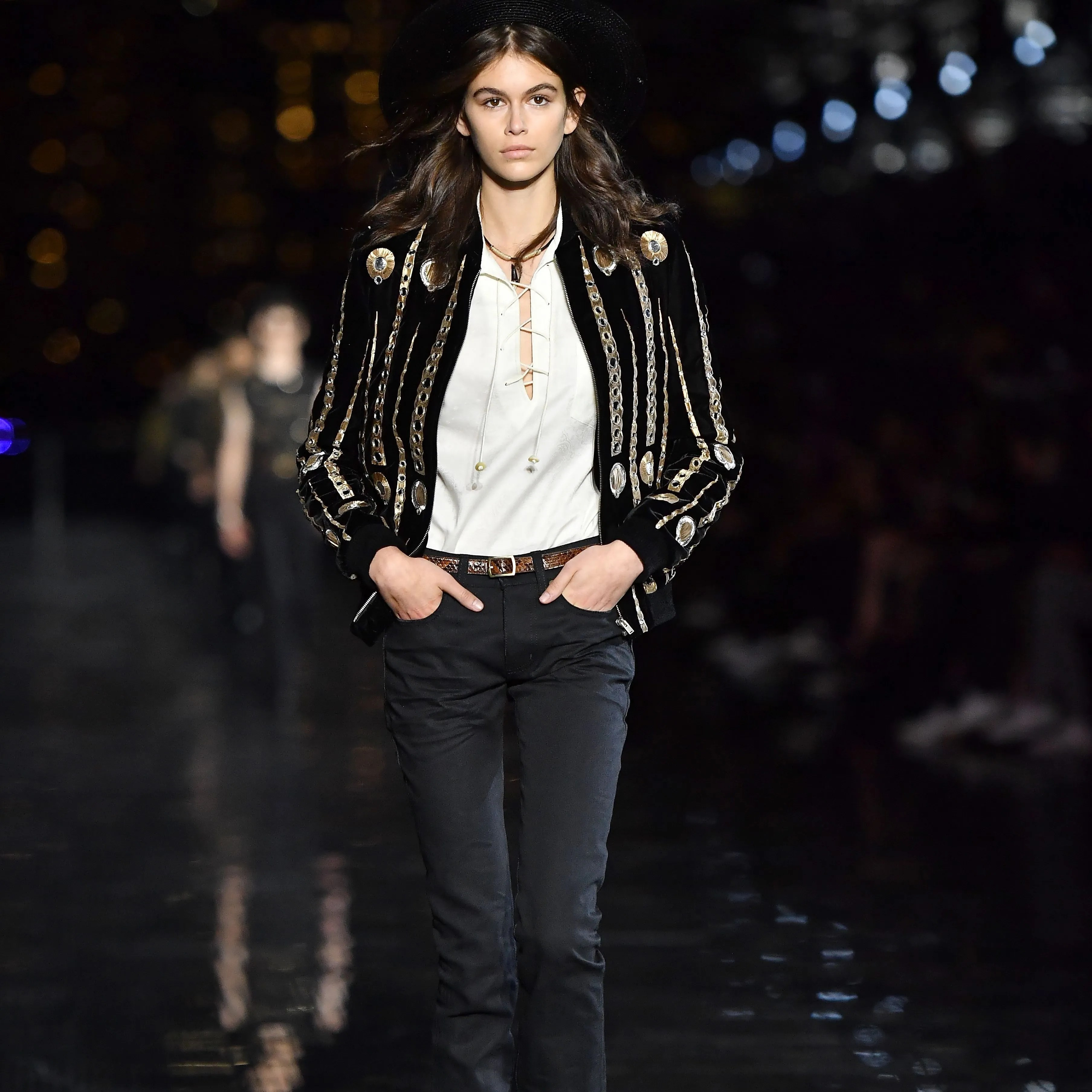 94dcd8a9dfbb2 Kaia Gerber opened up the Saint Laurent Men's Spring/Summer 2019 collection  wearing a bold jacket trimmed in gold, proving that a killer jacket knows  no ...