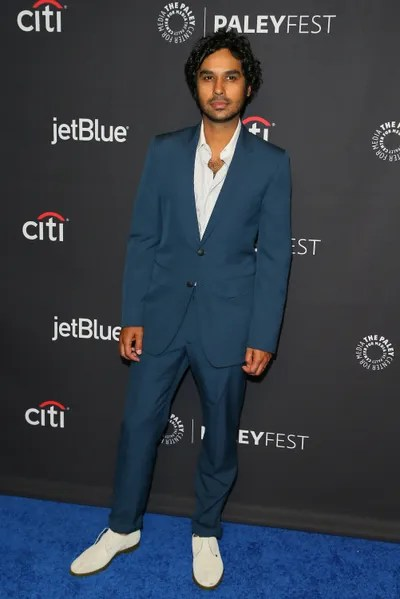 Image may contain Kunal Nayyar Footwear Clothing Apparel Shoe Coat Suit Overcoat Human Person and Man