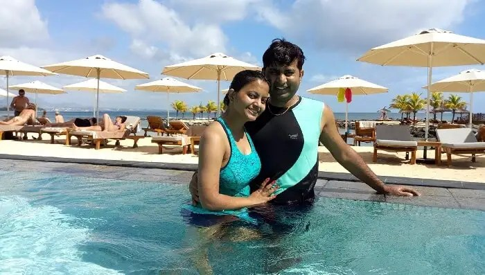 me and my wife at swimming pool