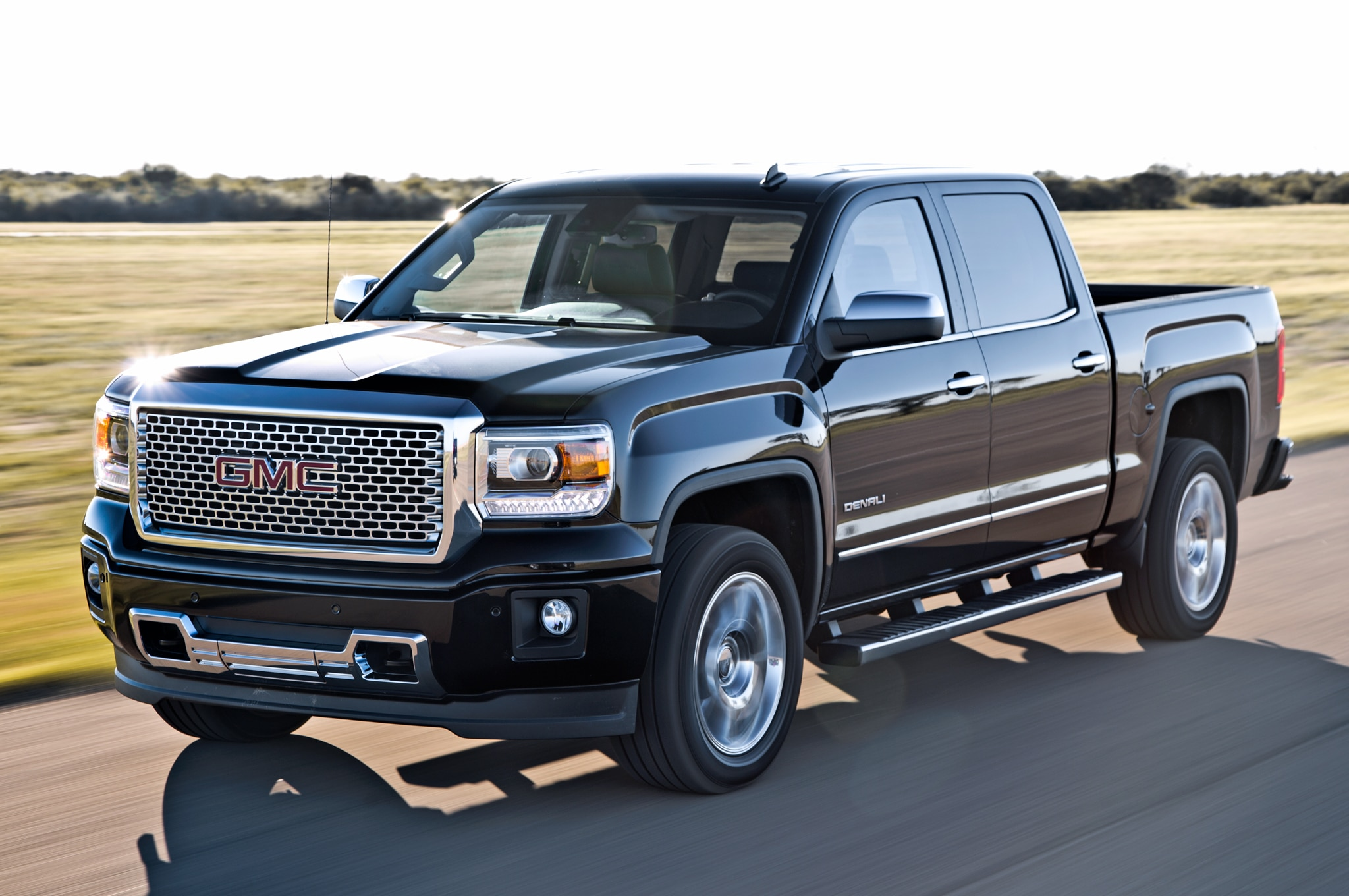 hight resolution of 2014 gmc sierra denali 1500 front three quarters view in motion