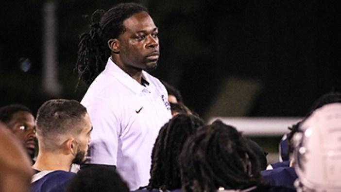 NAU vs Georgia Prep Coach Photo in Huddle