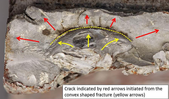 A close-up view of the fracture surface. Multiple cracks can be seen propagating from a major crack around the convex fracture surface. QinetiQ Photo