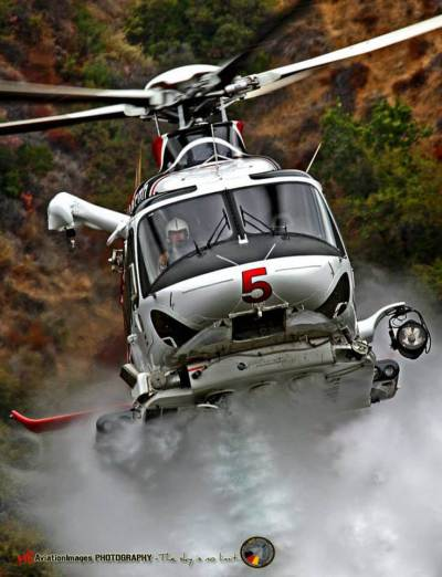 """Los Angeles Fire Department's """"Fire 5"""" starting to drop some water on Oct. 13"""