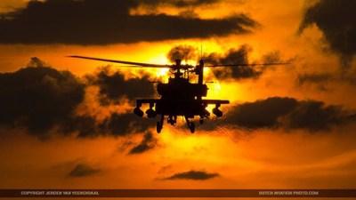 RNLAF Apache flying towards the sun.