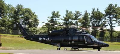 A Sikorsky S-76 sits on a helipad.