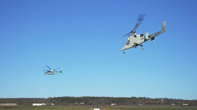 Two helicopters in flight