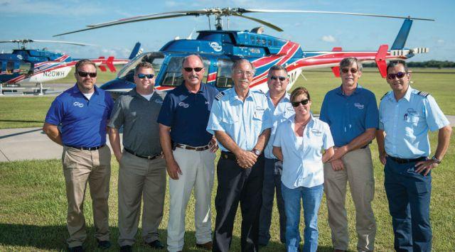 A portion of the Abbeville, Louisiana, crew. From left: Neil Collins (chief pilot), Mark Behne (BD), Bob McCoy (president), Harry Sowle (lead pilot), Dean Simpson (pilot), Amy Winch (customer service representative), Myron Hillers (director of maintenance), Jesus Colmenero (pilot).