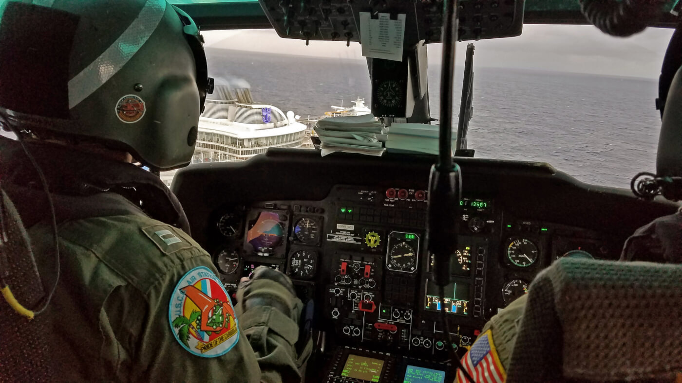 The crew of an MH-65D Dolphin from Air Station Borinquen in Aguadilla, Puerto Rico, conducted a medical evacuation from Harmony of the Seas on Dec. 26. Photos courtesy of Matt Udkow