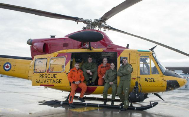 The Griffon crew from 424 Search and Rescue Squadron pose for a photo at Canadian Forces Base Trenton on Jan. 19, 2017. From left: MCpl Jeff Beaudry, SAR technician; MCpl Terry Shanks, flight engineer; Sergeant Cory Cisyk, SAR technician; Capt Stephanie Pouliot, pilot; and Capt Nicholas Bossé, pilot. RCAF Photo