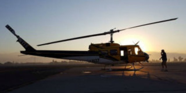 Helicopter Express has three modified Bell 205A-1 helicopters, as well as a Kaman K-MAX, conducting firefighting operations in Chile. Helicopter Express Photo