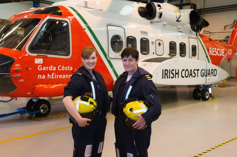 Capt. Dara Fitzpatrick, left, was the first victim of the Irish Coast Guard S-92 crash to be identified. She is shown here with Capt. Carmel Kirby in 2013 when they flew as the Coast Guard's first all-female SAR flight crew. Irish Coast Guard Photo