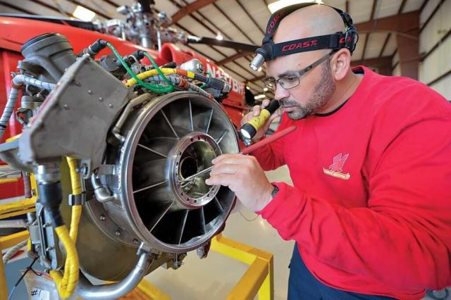 Senior maintenance technician Roberto Velez, here inspecting a GE T700-GE-701C/D engine, is one of Firehawk's longest-tenured employees.
