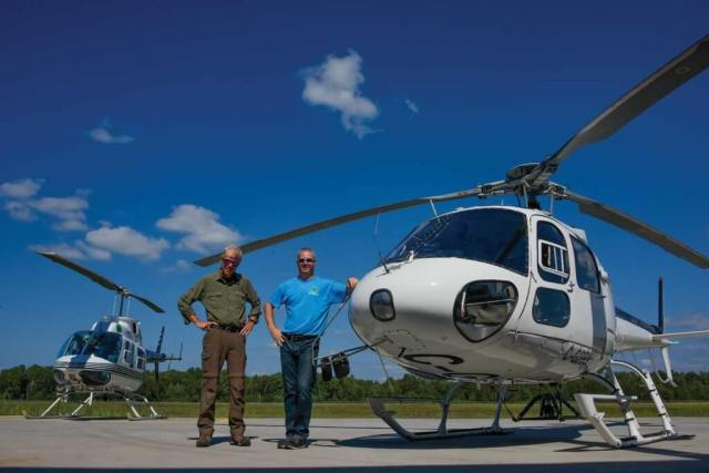 Gord Bain (left), a seasonal pilot with Heli Muskoka, stands alongside McMackin on the flight line. Bain brings huge experience to his role, having flown for more than 30 years with the Ontario Ministry of Natural Resources and Forestry.