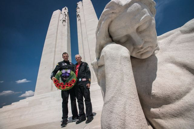Steven Dengler, left, and his father Bob carry a wreath at the Canadian National Vimy Memorial in France in the summer of 2017.