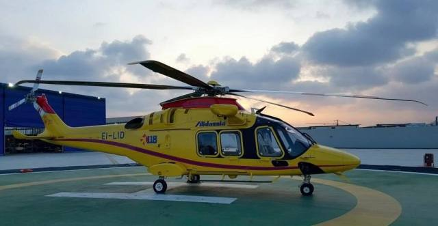 Helicopter resting on helipad
