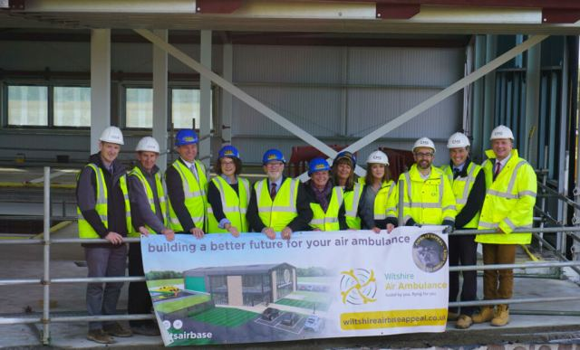 Representatives of Wiltshire Air Ambulance, its primary contractor Rigg Construction (Southern) Limited, and its architects and project managers gather inside the new airbase construction site for the topping out ceremony. Wiltshire Air Ambulance Photo