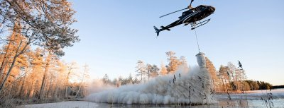 Scandair helicopter using an H125 to spread lime, ash or forest manure.