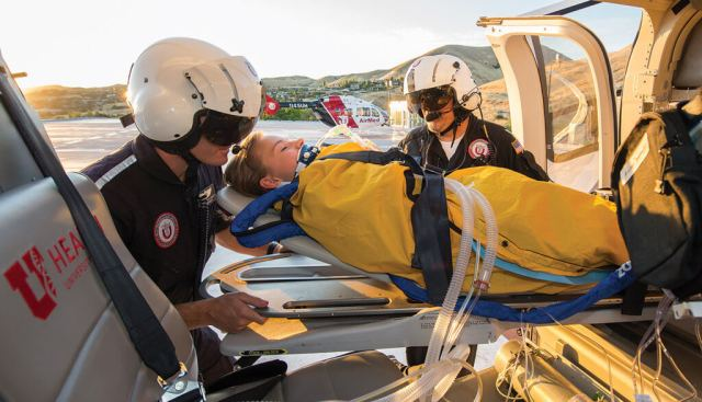 Flight paramedic Bryson Westbrook and flight nurse Brian Simpson unloading a patient at the UUHC rooftop helipad. Dan Megna Photo