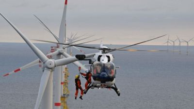 A Wiking Helicopter Service crewmember is hoisted down to a wind turbine from one of the company's Airbus H145s. According to Waypoint Leasing, Airbus leads the market in providing helicopters to the offshore wind turbine support industry. Wiking Helikopter Photo