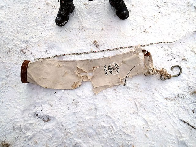 A damaged supply bag found at the scene of the crash.