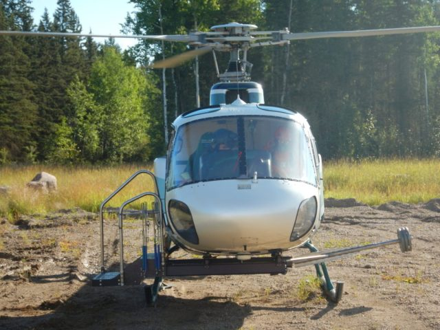 The AStep platform is mounted on the right side of the Airbus A350 B2, and a counterweight runs under the helicopter's framework. Slave Lake Helicopters Photo