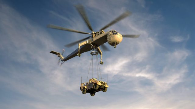 The S-64F+ Air Crane ideally will perform back-end automatic logistics missions, freeing pilots to perform more complex combat flying. Here it lifts an Army Joint Light Tactical Vehicle. Erickson Image