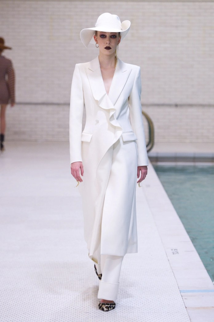 Image result for Area This pantsuit is what we imagine a modern-day Bianca Jagger would take the plunge in—floppy white hat and studded, leopard-print pumps included.