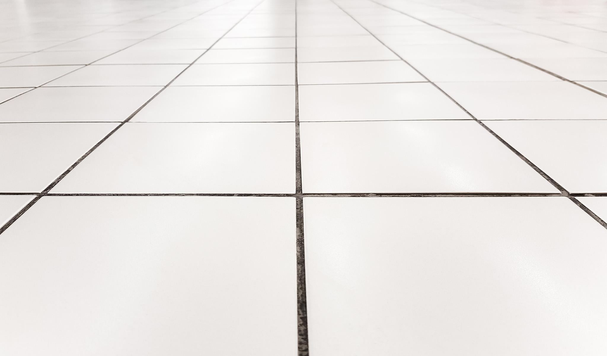 don t tile over vinyl flooring