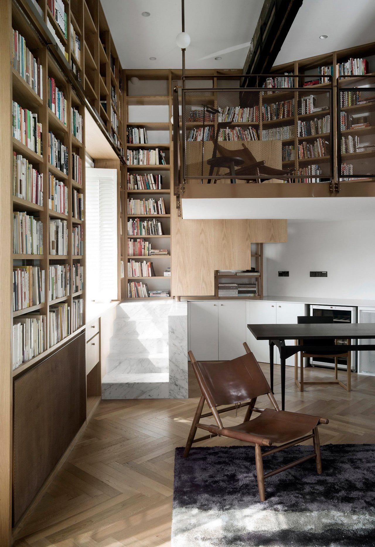 Shanghai Apartment Lined With FloorToCeiling Bookshelves