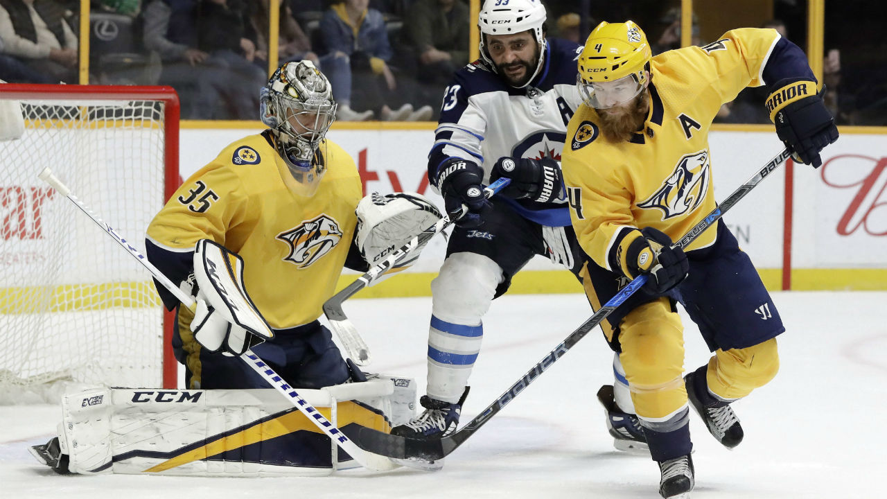 hight resolution of winnipeg jets dustin byfuglien and nashville predators ryan ellis chase a rebound after predators