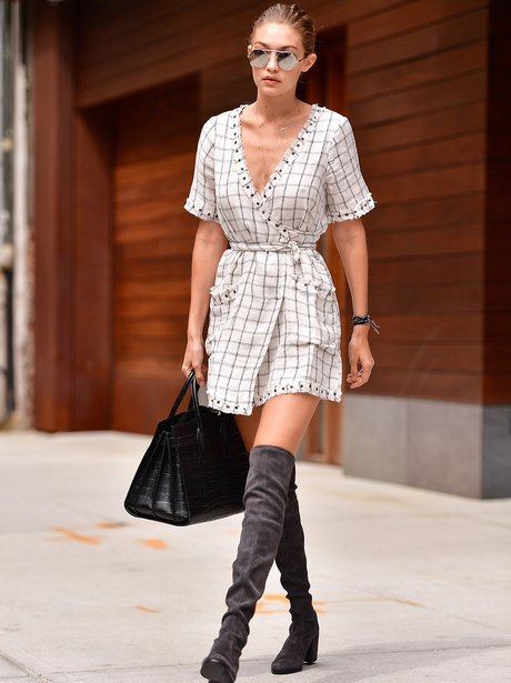 Image result for Gigi Hadid in Wrap dress and thigh high boots