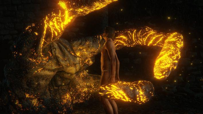 A giant glowing hand envelops an undressed man in an Elden Ring screenshot.