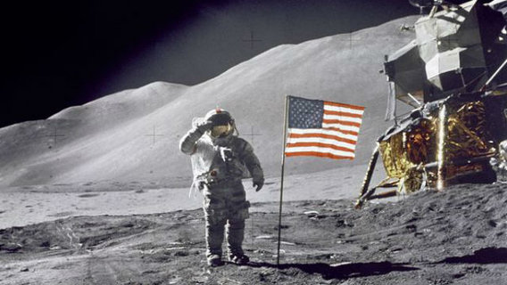Moonwalking astronaut salutes the U.S. flag on the Moon. Twelve people went to the Moon, all of them in the U.S. space program run by NASA.  (My photo source does not identify this astronaut.)