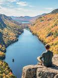 man relaxing in adirondack mountains