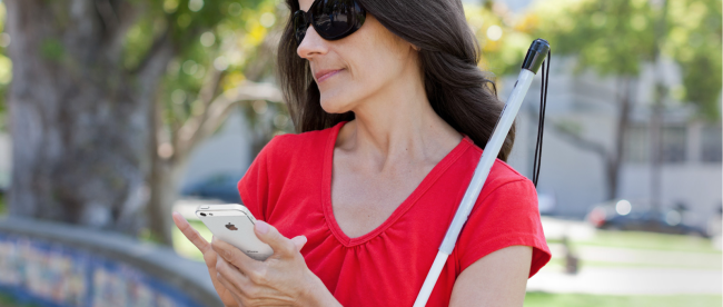a blind woman navigating an iPhone with her right hand