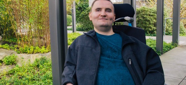 photo of chris schlechty, a microsoft employee in his wheelchair.