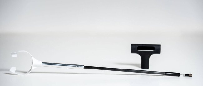 TubusOne shown with an attached mouthpiece. There is also a stand resting in the background.