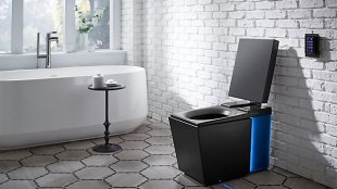 Photo of kohler's numi intelligent toilet in a bathroom.