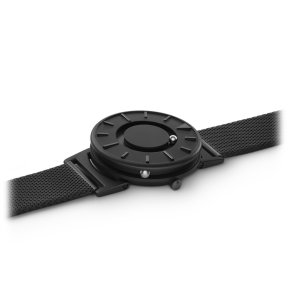 the eone watch has a marble for hour inside the watch, marks for hours and another marble on the side for minutes. By simply touching these marbles and marks, a blind person can tell what the time is.