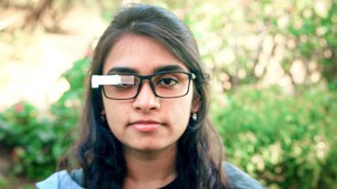 A woman seen wearing glasses with TranscribeGlass attached to them.