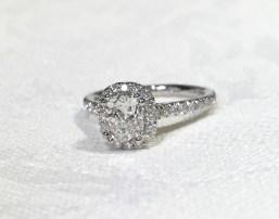 Custom made cushion shape diamond, with a cushion shape diamond halo