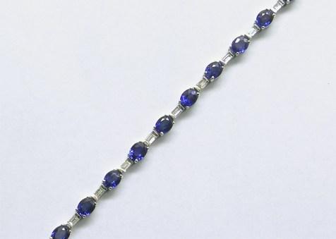b-143 Oval blue sapphire & baguette diamond bracelet in 14K white gold