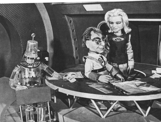 Robert the Robot awaits instructions, while Professor Matthew Matic talks to Venus