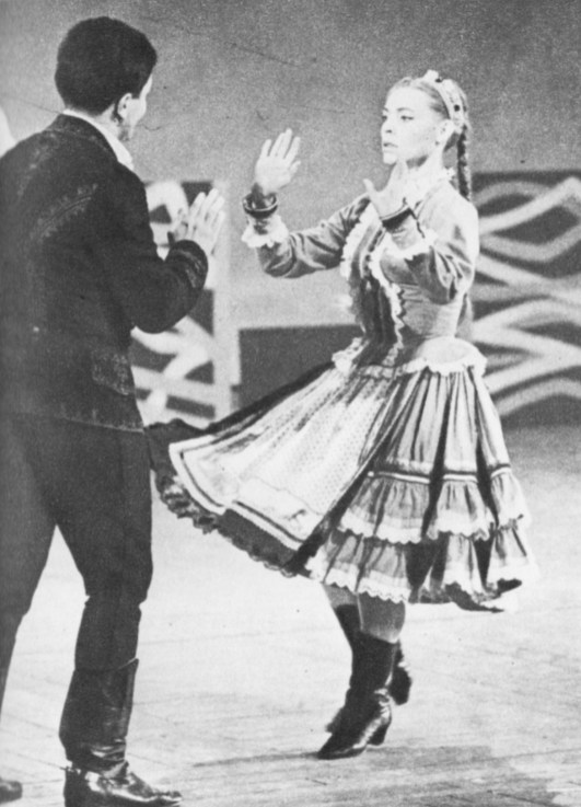 All the verve of Central European folk dancing is captured in this picture of two members of the Hungarian State Dance Ensemble