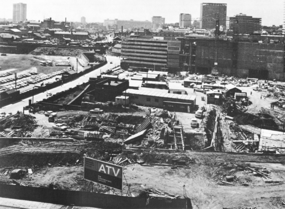 A building site, with a billboard that says 'ATV - The Entertainment Network'