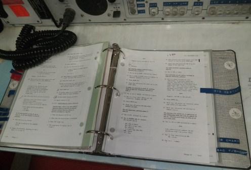 Procedures book on one of the launch desks inside the Delta-01 capsule. (c) J.S. Reinitz 2013