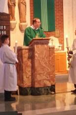 Deacon Kevin offers the Gospel.