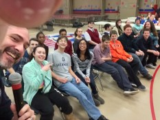 Spelling Bee moderator, Chancellor Mike Walsh, starts off the contest with a selfie with the 8th graders.